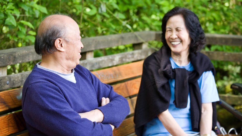 happy mature asian couple having fun